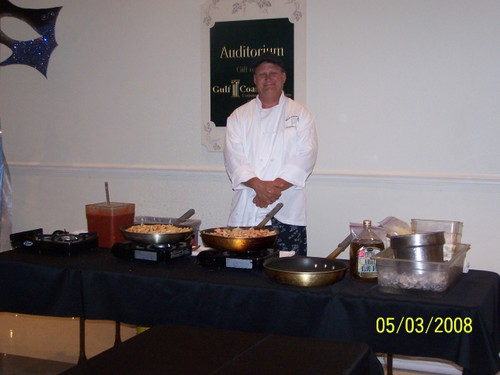 Dave Chace serving pasta at one of the stations at the Port Charlotte Prom